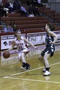 Cedar Springs varsity girls basketball picked up two more wins last week. In the photo above, Shaelyn Fasel dribbles the ball for the Red Hawks.