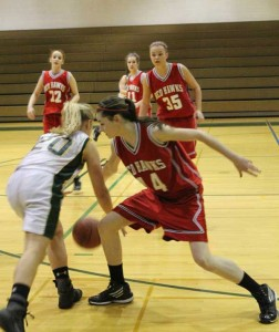 #14 Aly Hamilton getting the steal against Comstock Park. Photo by Ron Francis.