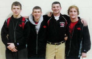 Pictured is sophomore Jared Vodry, senior Austin Wamser, Coach Scott Troost, and junior Cody Oehme.