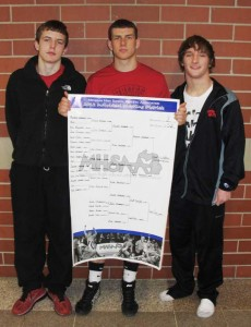 Red Hawk wrestlers place at regionals. (L to R) Sophomore Jared Vodry 4th, senior Austin Wamser 1st, and junior Cody Oehme 3rd.