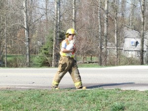 Firefighter calms dog after accident. Post photo by J. Reed.
