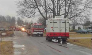 Firefighters on scene of house fire in Sparta Township. Photo from WOODTV.com