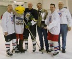 Sgt. Ed Good, Griff, Lt. Jack Stewart, Sheriff Larry Stelma, DPW Director Roger Belknap and Chief Roger Parent at the Hockey and broomball fundraiser for the library last Saturday.