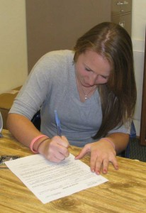 Taylor Nielsen signs with Argos Of Great Falls University in Montana.