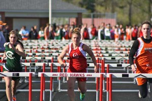 Abby VanDusen (center) in the 100 meter hurdles.