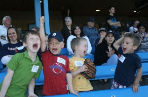 Boys cheering for the Whitecaps at the Mother-son outing.