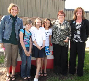 Students at Cedar View presented Special Olympics with a check for $948 Monday. From left to right: Special education teacher Chris Leslie, fifth grade students Marissa Whitney, Sierra Hess, and Mae Larsen, Special Olympics representative Diane House, and Independent Bank representative Julie Wheeler. Post photo by J. Reed.