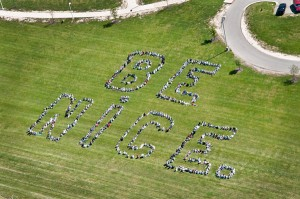 "Cedar Springs Middle School students had a ""white out"" last Friday, May 12, and was one of several schools that participated in a helicopter flyover as part of the be nice. campaign (against bullying). Photo by Joe Corriveau."