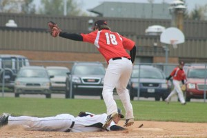 Red Hawk sophomore, Collin Hickok keeps the runner close at first base.
