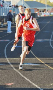 MavRick Cotten handing off to Nate Jones in the 800m relay.