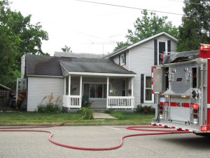 Smoke came from roof on the left side of the porch. Post photo by J. Reed.