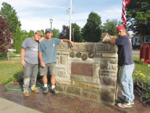 Stonemasons who volunteered their time to move and rebuild the World War I/II monument are (L to R) Joel VanVeldhuizen, Jim Phillips, and Terry Merlington.