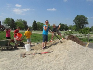 Sand Lake students work on library landscape. Post photo by J. Reed.