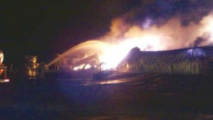 Nelson's Speed Shop in flames last Friday morning. 