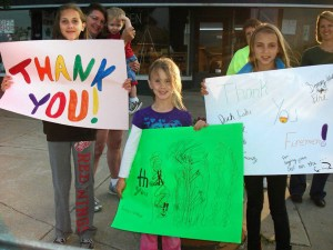 Area residents lined the streets of Newberry on May 27 to welcome home returning firefighters--a wonderful sight for the hard-working crews!
