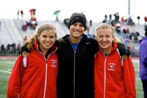 Connor with All-State distance sisters Kenzie (left) and Katie Weiler.