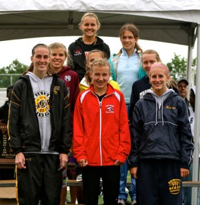 Katie Weiler (Middle Front) and Kenzie Weiler (Left in 2nd row) on the awards stand with the other placers in the 3200 run.
