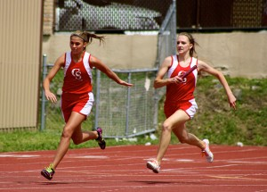 Rieley Hondalus and Marissa Oakes in the 400 Relay.