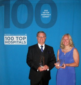 Spectrum Health United Hospital Board President, David Mack, and Spectrum Health United Hospital President, Tina Freese-Decker, with 100 Top Hospitals® Award.