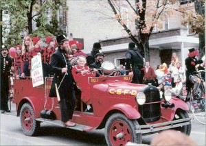 Cedar Springs Clipper Editor Nina Babcock gets a ride on the old Model A fire engine during a Red Flannel celebration, year unknown.