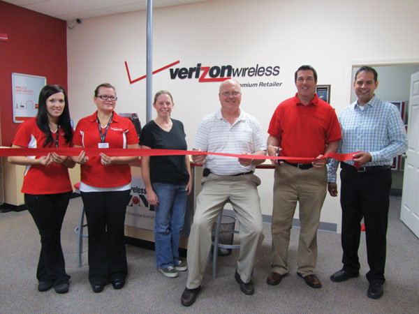 Pictured from left to right: Page Segard, Sales executive; Renee Doren, Store manager; Brynadette Powell, Treasurer Cedar Springs Area Chamber of Commerce; Charlie Watson, Mayor of Cedar Springs; Derrek Fridley, President and owner; and Randy Johns, Verizon account manager.