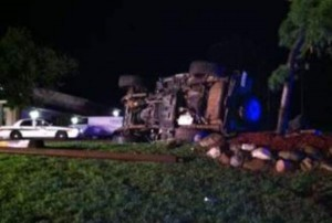 Four men were injured in this rollover accident Saturday night in Algoma Township. Photo courtesy Woodtv.com.