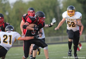 Red Hawk Dylan Block runs with the ball.