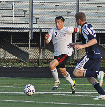Red Hawk Aaron Dault moves the ball upfield.