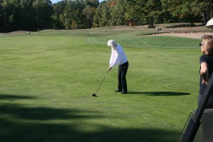 Librarian Donna Clark tried her hand at golf during the Golf with Friends benefit for the library. Photo courtesy of Becky Powell.