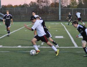 Red Hawk Julion Quiroga battles for the ball.