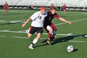 Senior Kyle Szirovecz drives the ball upfield.