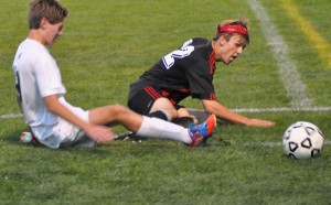 Trevor Rose fights for control of the ball.