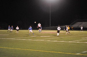 Tyler Aungst #21 heads the ball towards #23 Gabe Zwinger at game against Sparta