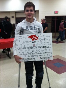 Sean Thompson with an award given to him by teammates at his football awards banquet. Courtesy photo.