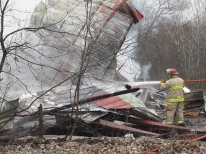 Firefighters fought a barn fire behind Harvard Tavern Friday morning. Post photo by J. Reed.