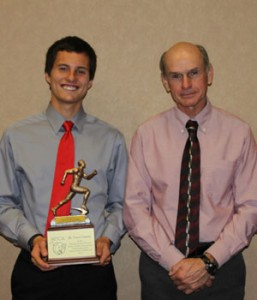 Cedar Springs Senior Connor Mora with Cross Country Coach Ted Sabinas.