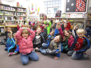 Carrie Dault's kindergarten class holding money they couldn't wait to donate to the Cedar Springs Public Library. Post photo by J. Reed.