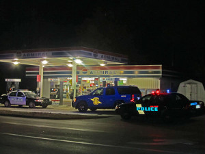 This was the scene when the Admiral Gas Station at the corner of Main and Muskegon when it was robbed in October. It was robbed again Saturday evening, December 22. Post photo by J. Reed.