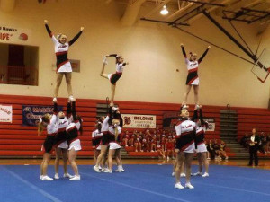 Varsity cheer team during competition.