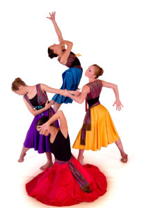 "Mia Calabrese, a former Cedar Springs student, and now a professional ballet dancer, will appear in Ballet Emmanuel's ""Courage"" at Cedar Springs High School Wednesday, Feb. 13.  Pictured clockwise from the right: Mia Calabrese (yellow), Laci Landry (red), Erin Benson (purple), and Melanie Dexter (blue)."