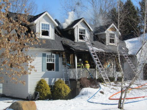 Firefighters fought a fire at this home in Oakfield Township for several hours Friday.