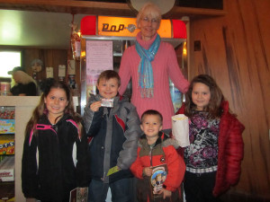 "Kids celebrated ""March is Reading Month"" by getting their library card and seeing ""Wreck it, Ralph"" at the Kent Theatre Monday and Tuesday. Library Director Donna Clark with several children at Tuesday's showing. Post photo by J. Reed."