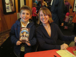 Author Amanda Litz with a young fan at the reading celebration at The Kent Theatre. Post photo by J. Reed.