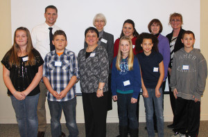 Photo cutline: Award winners, teachers and Rotary representatives for the Rotary 4-way test. Back: (L to R) CTA teacher Aaron Kenemer, Donna Clark, Amanda Gerhardt, Carolyn Davis, and Julie Wheeler. Front row (L to R): Ashley Shelagowski, David Whitten, Mrs. Luttrell, Katelyn Hoogerheide, Alyssa Washington, and Nicholas Cummings. 