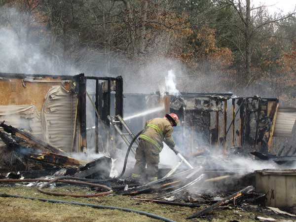 Fire ripped through this home in Algoma Township Monday. Post photos by J. Reed.