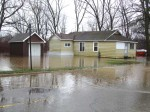 This house on Fifth Street north of Cherry was surrounded by water.