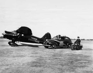 Plane, patrol vehicle, and motorcycle from the 1930s.