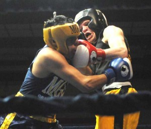 Sand Lake boxer Zach Schmuck lost a close decision last Saturday but will box in the state finals.
