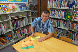 "Matthew Landry was the first to register his family for the CS Public Library's Summer Reading Program, ""Dig into Reading."""