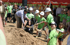 In memory of Nate—Children wield golden shovels for groundbreaking of the Miracle League Nate Hurwitz Field on Ten Mile Road. Nate, a fan of baseball who had Duchenne's Muscular Dystrophy and was a member of the West Michigan Miracle League Board of Directors, passed away in 2012 at the age of 16.